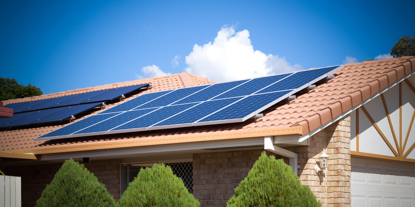 Solar panels on suburban house roof