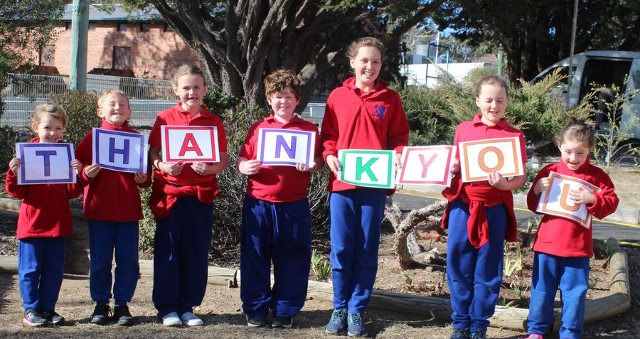 Kids of the school holding letters of the word thank you