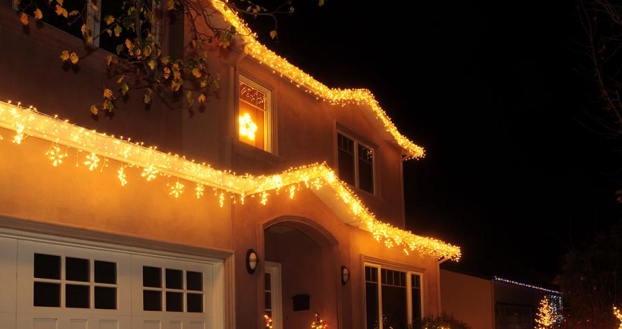 House decorated with Christmas lights at night