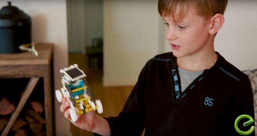 Boy showing solar powered toy car