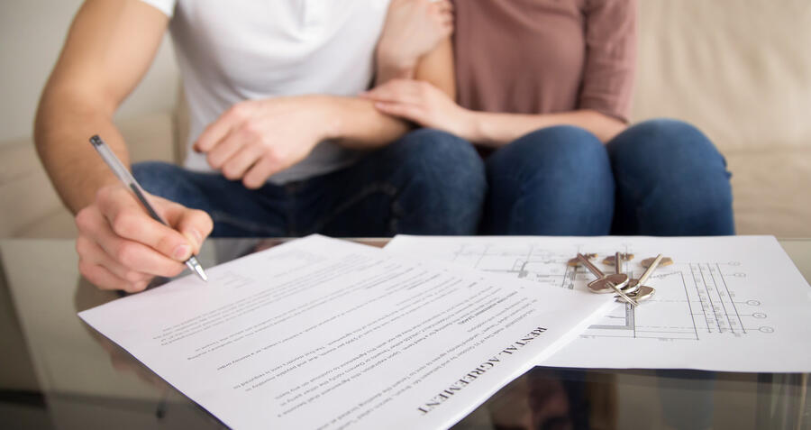 Couple signing rental agreement